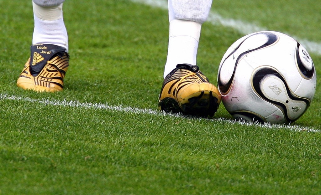 German national soccer team captain Ballack wears new boots during a friendly match in Geneva