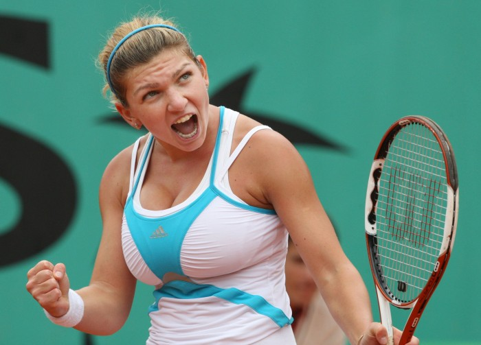 Romanian Simona Halep celebrates after winning a point against compatriot Elena Bogdan during their French tennis Open final match in the category junior at Roland Garros on June 08, 2008 in Paris. Halep won 6-4, 6-2.  AFP PHOTO / Pierre Verdy